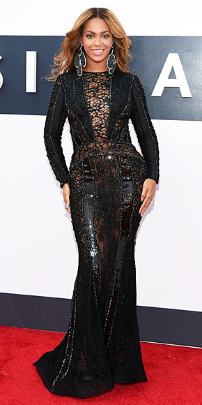 Beyonce in a fabulous long sleeve sheer black gown, paired with seriously HUGE Lorraine Schwartz dangly earrings