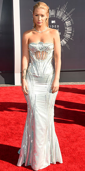 Iggy Azalea in a futuristic looking Altier Versace gown, again with sheer embellishments and cutouts.