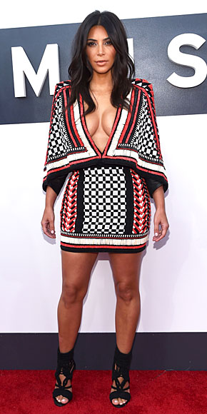 Symmetric patterns, good layering and extensive beading and embellishments! I love this dress worn by Kim Kardashian