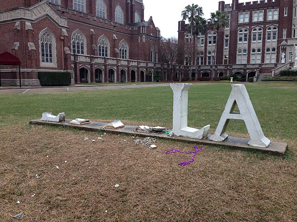 Mardi Gras Revelers Steal Y-O-L-O from Loyola Sign