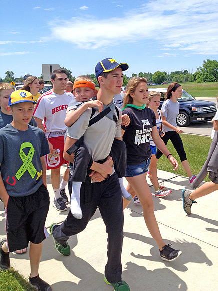 Teen Completes 40-Mile Walk Carrying His Brother to Raise Awareness About Sibling's Disorder| Good Deeds, Real People Stories