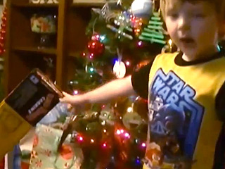 Watch Boy's Hilariously Appropriate Reaction to Brother's BB Gun Gift