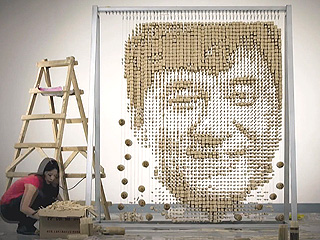 Artist Creates Portrait of Jackie Chan with 64,000 Chopsticks