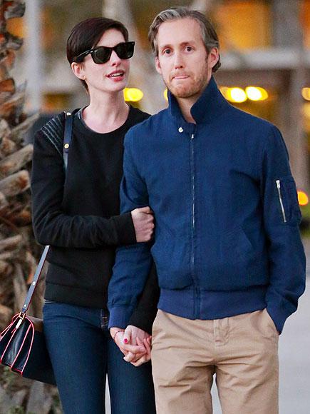 HAND IN HAND photo | Anne Hathaway