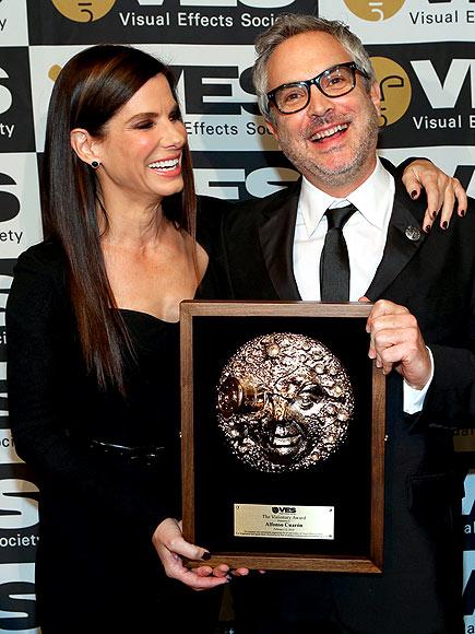 WINNING SMILES  photo | Alfonso Cuaron, Sandra Bullock