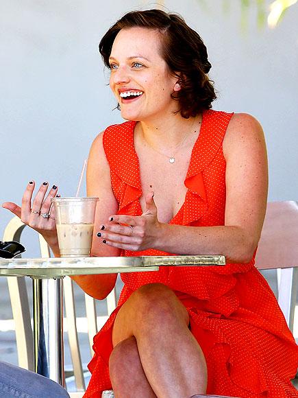 DRINKING IT IN photo   Elisabeth Moss