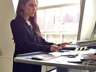 PHOTO: Victoria Beckham Stands on Treadmill Desk – in 5-Inch Heels!