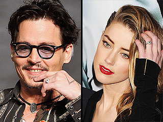 Johnny Depp Is Wearing 'a Chick's Ring' – Is It Amber Heard's Engagement Bling?