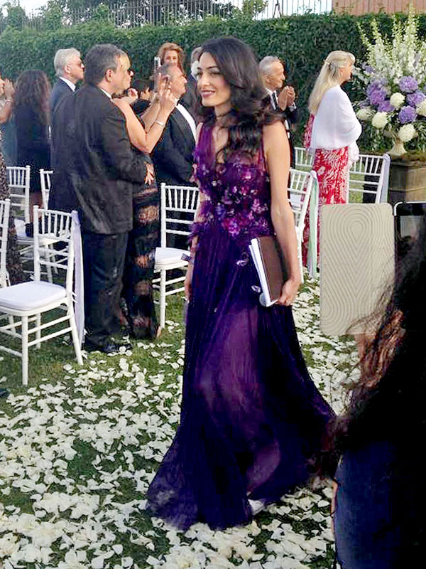 Amal Alamuddin purple gown at cousin's wedding
