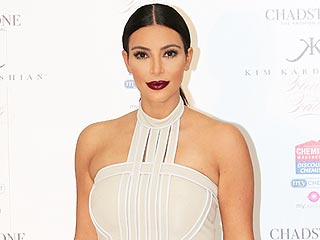 Whoa! Kim Kardashian Ditches Pants, Savors Cupcake on New Magazine Cover