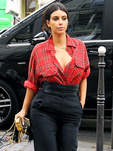 UNBUTTONED AND CLEAVAGE-BARING photo | Kim Kardashian