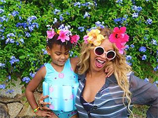 VIDEO: Flower Power! Beyoncé and Blue Pose and Dance with Floral Headpieces During Family Getaway
