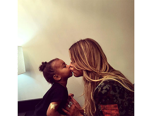 Khloe Kardashian and North West kiss