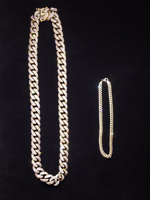 kim kardashian shares pic of matching chain for kanye west