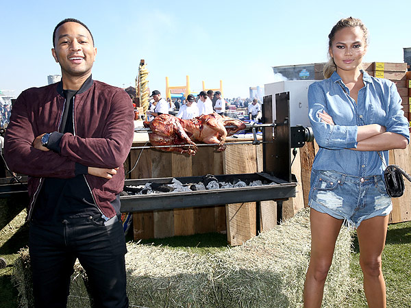 John Legend (L) and model Chrissy Teigen