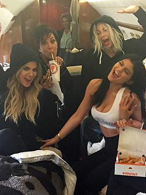 Kylie Jenner eating Popeyes on a jet