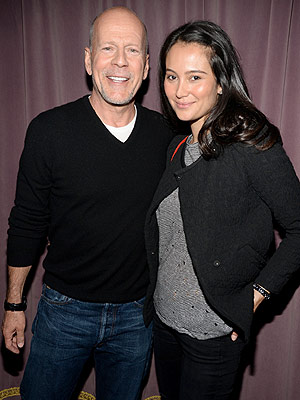 Actor Bruce Willis (L) and Emma Heming