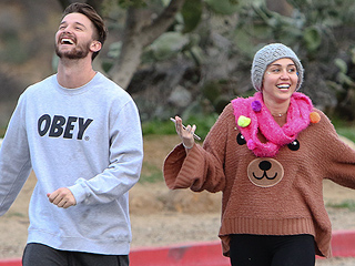 Miley Cyrus Bonds with Arnold Schwarzenegger over the Holidays