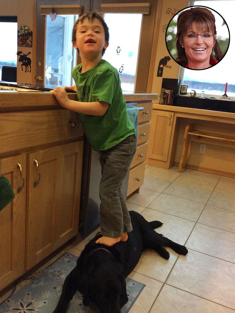 Sarah Palin Posts Photos Of Son Trig Using Family Dog As A