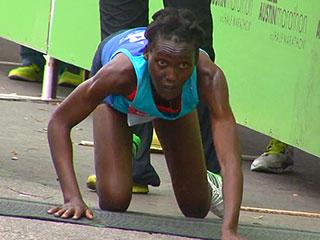 Kenyan Runner Crawls to the Finish Line at the Austin Marathon (PHOTO)