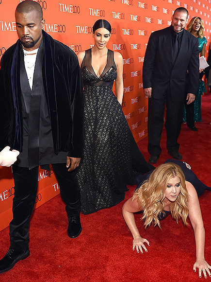 We're Floored: Amy Schumer and Her Trainwreck Cohorts Spoof Her Kim Kardashian and Kanye West Red Carpet Prank| Movie News, Amy Schumer, Judd Apatow, Kanye West, Kim Kardashian