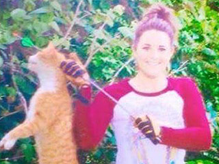 Texas Vet Posts Shocking Facebook Photo of Cat She Shot as Her 'First Bow Kill'