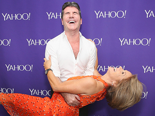 Smooth Move! Simon Cowell Sweeps Katie Couric Off Her Feet with Dapper Dip on the Red Carpet