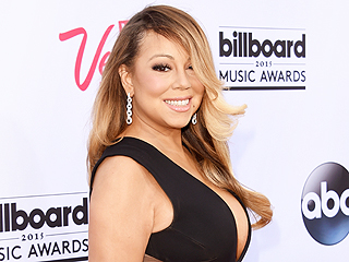FROM EW: Mariah Carey Delivers Career-Spanning Performance at Billboard Music Awards