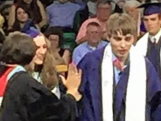 Teen Lovingly Escorts Autistic Twin Across the Stage at Their High School Graduation