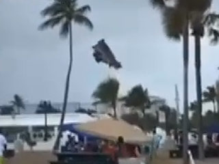 Three Children Injured When Waterspout Carries Bounce House into the Air (Video)