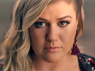 FROM EW: Kelly Clarkson Is 'Invincible' in New Music Video