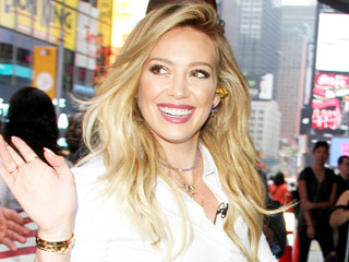 Hilary Duff Shows Off Her Curves in Booty Shorts and Fishnets