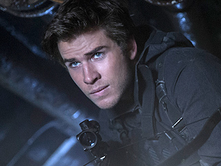 Brothers, Unite! Liam Hemsworth Gears Up for Action in Exclusive Hunger Games: Mockingjay – Part 2 Poster