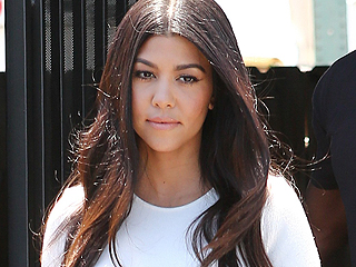 Kourtney Kardashian Steps Out as Photos Surface of Scott Disick Getting Cozy with Another Woman