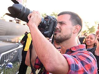 Budding Photographer? Taylor Lautner Shoots London Music Festival Headlined by Nicki Minaj, David Guetta