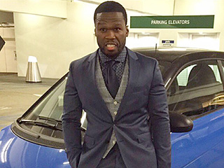 50 Cent Jokes About Bankruptcy by Posing Next to a Smart Car