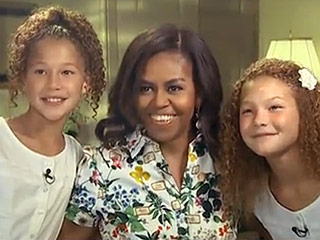 Michelle Obama, Lobbyist? First Lady Presses Michael Strahan to Get His Daughters a Dog