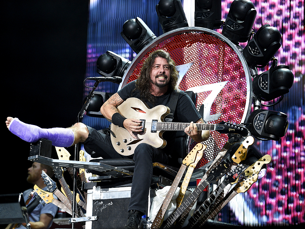 Watch Dave Grohl Rock Out with His Orthopedic Surgeon Onstage at Boston Foo Fighters Concert| Foo Fighters, Music News, Dave Grohl
