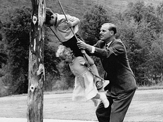 Royals #TBT: Young Prince Charles Gets a Playful Push from Dad Prince Philip During a Trip to Balmoral