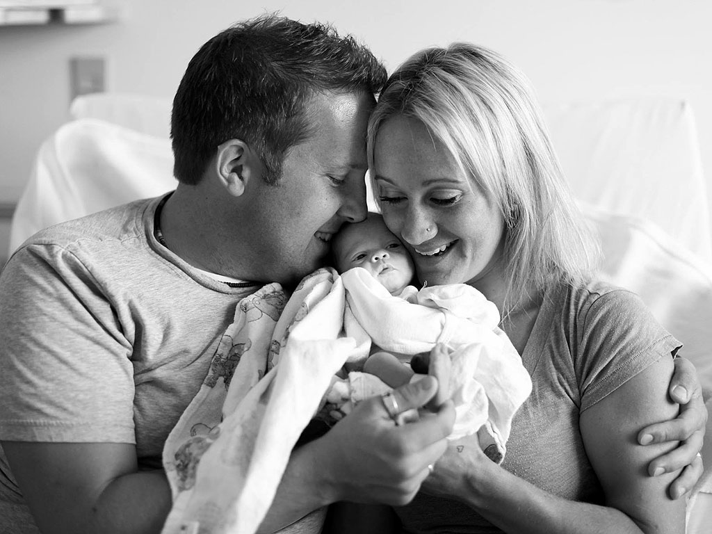 adoptive parents meet baby for first time