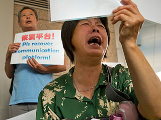 Frustrated Relatives of MH370 Passengers Demand Answers as More Aircraft Debris Is Found on Réunion Island