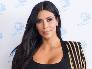 Kim Kardashian Says the Reason She Never Smiles Stems from Her First Pregnancy: 'It Changed My Personality'