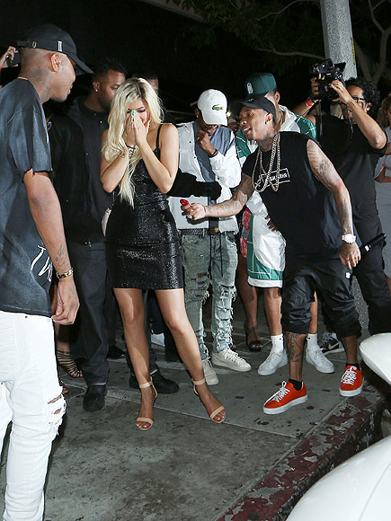 Tyga surprising Kylie Jenner last year outside Bootsy Bellows