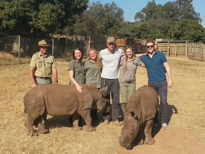 Prince Harry Hangs with Baby Rhinos on African Conservation Trip – and He Has a Beard!| The British Royals, The Royals, Prince Harry