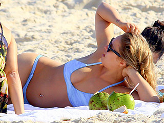 UFC Champ Ronda Rousey Is a Knockout in a Bikini