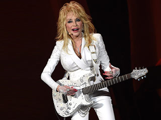 FROM EW: Dolly Parton Denies Stomach Cancer Rumors: 'There's Absolutely No Truth' to the Story