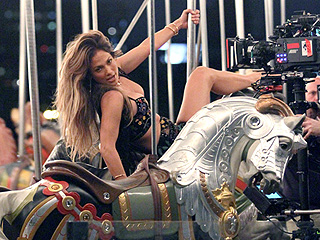 Jennifer Lopez Flaunts Her Amazing Bod, Rides a Carousel and More in New Music Video with Spanish Hottie Alvaro Soler (PHOTOS)