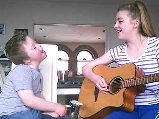 Boy with Down Syndrome Joins Big Sister in Heartwarming Acoustic Rendition of 'Titanium'