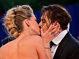 Round Two! Amber Heard and Johnny Depp Pack on the PDA While Walking the Red Carpet for The Danish Girl