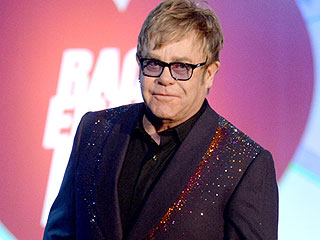 FROM EW: Elton John Pens Op-Ed About AIDS Activism: 'We Have So Much Work Left to Do'